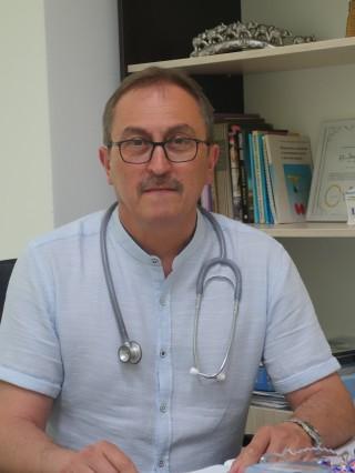 Д-р Роман Ризов