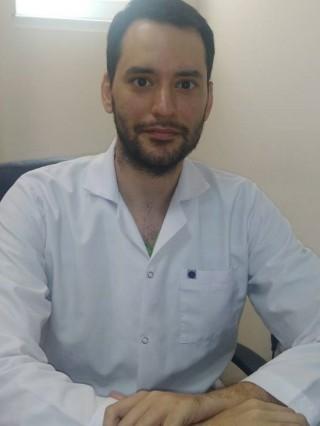 Д-р Серджан Челикканат